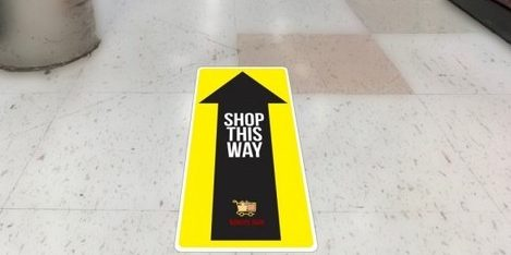 Social distancing floor graphics help direct traffic in your business.
