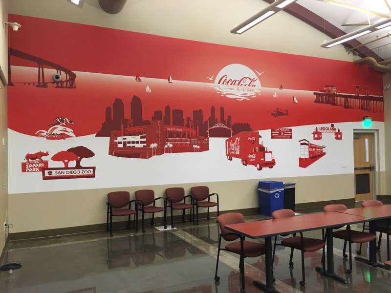 A decorative corporate wall mural is a subtle way to reinforce your brand.