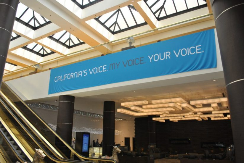 Image of vinyl banner placed indoors beside an escalator.