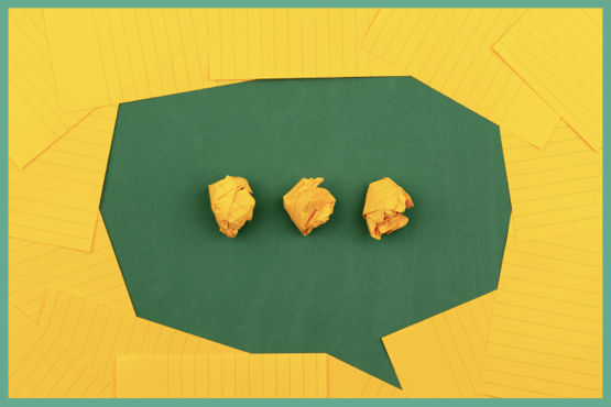 Green speech bubble, with ellipses made up of scrunched up yellow paper. Yellow background.