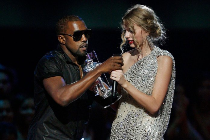 "Singer Kanye West takes the microphone from singer Taylor Swift as she accepts the ""Best Female Video"" award during the MTV Video Music Awards in 2009"