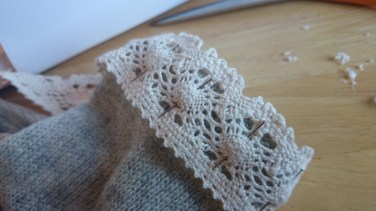 Turn back inside in, attach cotton lace around the end. Sew .