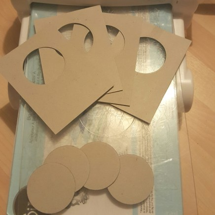 Pieces with apertures cut out, and saved cut out pieces