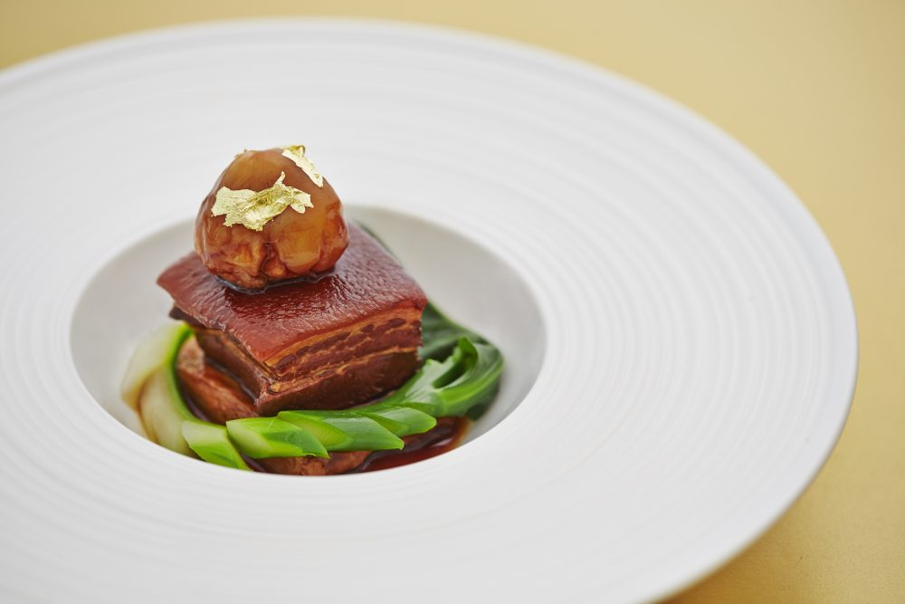 Digital Agency Case Study - Orchard Hotel Singapore - Hua Ting's Kurobuta Pork in a white plate with green vegetables and luxurious gold film