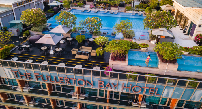 The Fullerton Bay Hotel Singapore's rooftop pool with model and trees