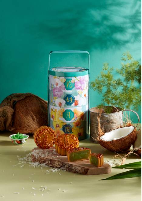The Fullerton Mooncakes Premium Tingkat Treasures 2020 with a lunchbox and baked mooncakes on green background