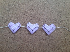 tuck in the flaps. you can use glue to secure the hearts, but it's not needed.