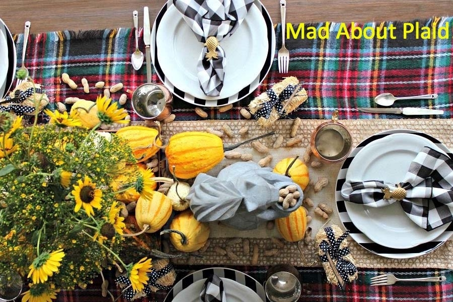 An on trend plaid table runner sets off this holiday table.