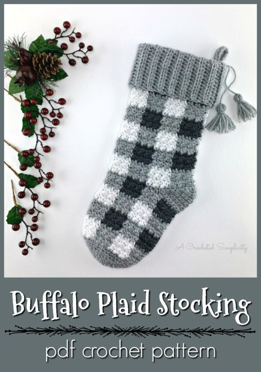 Super fun buffalo plaid crocheted stocking pattern. Perfect classic pattern for a crocheted Christmas stocking! I can't wait to make this pattern. Love the tassel detail! #crochetpattern #buffaloplaid #plaidcrochet #christmascrochet #christmastockingpattern #crochetstocking #craftevangelist