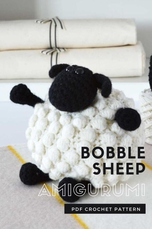 Adorable Bobble Sheep Crochet Amigurumi Pattern. Love this cozy looking sheep! It could almost be a throw pillow on a bed! So cute! #crochetpattern #amigurmipattern #crochetsheeppattern #diytoys #crochettoypattern #craftevangelist