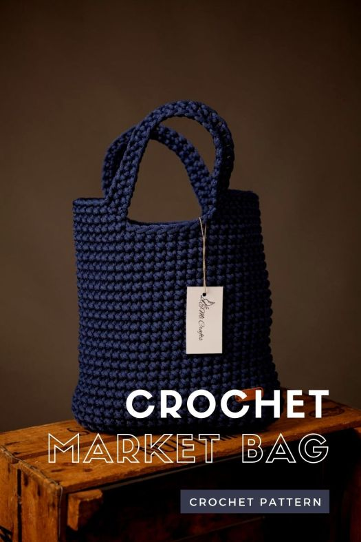 Beautifully simple and sleek, tightly woven fabric on this gorgeous crochet market bag. Haul all your heaviest stuff in this sturdy handmade bag. Lovely crochet pattern to try! #crochetpattern #crochethandbag #crochetmarketbag #craftevangelist