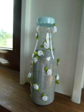 rose bottle w. silver gravel
