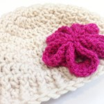 Free Pattern For A Crocheted Newborn Hat With Pink Flower made by Habiba from CraftifyMyLove.com