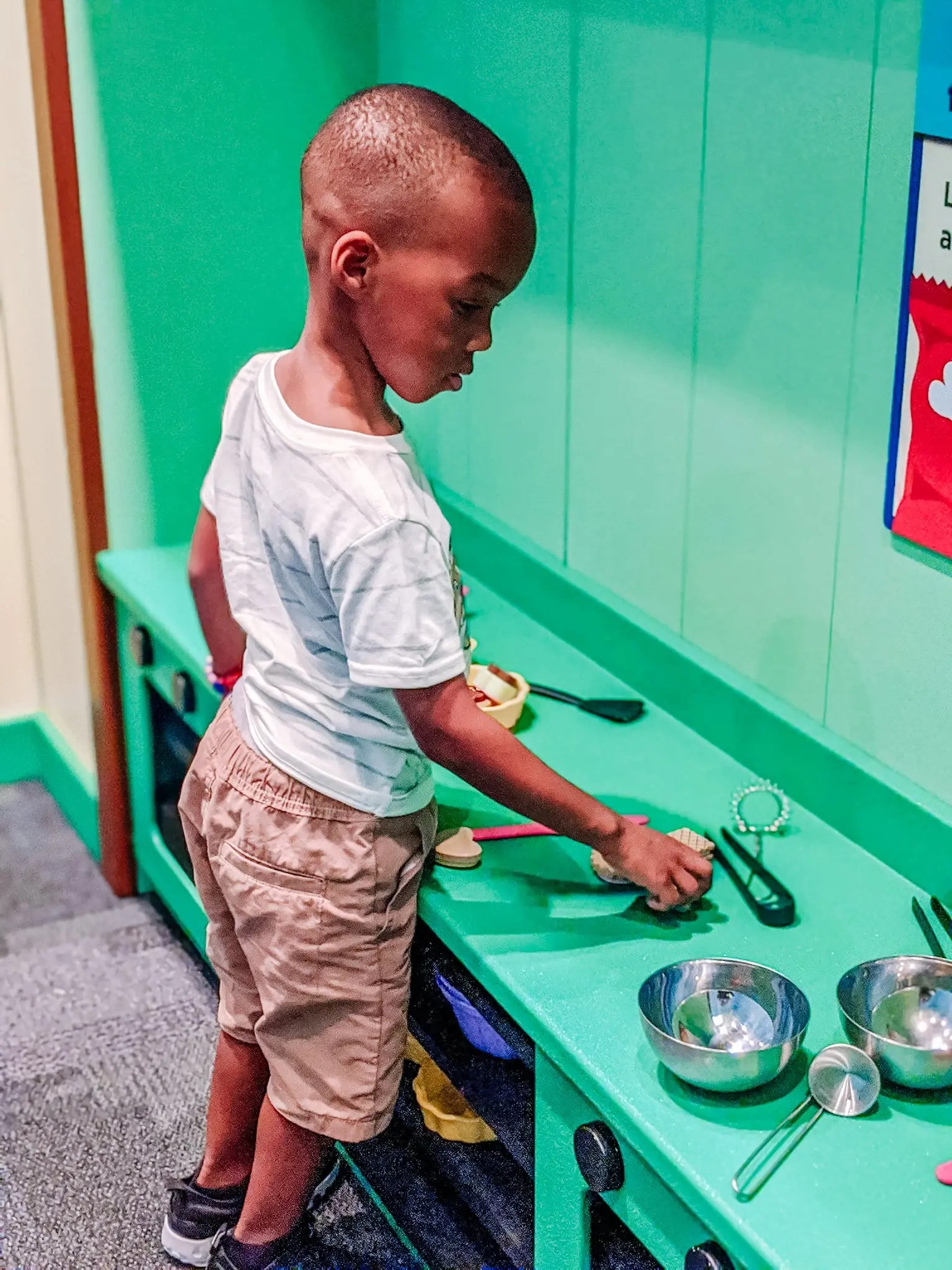 Black boy playing at the Glazer Children's Museum