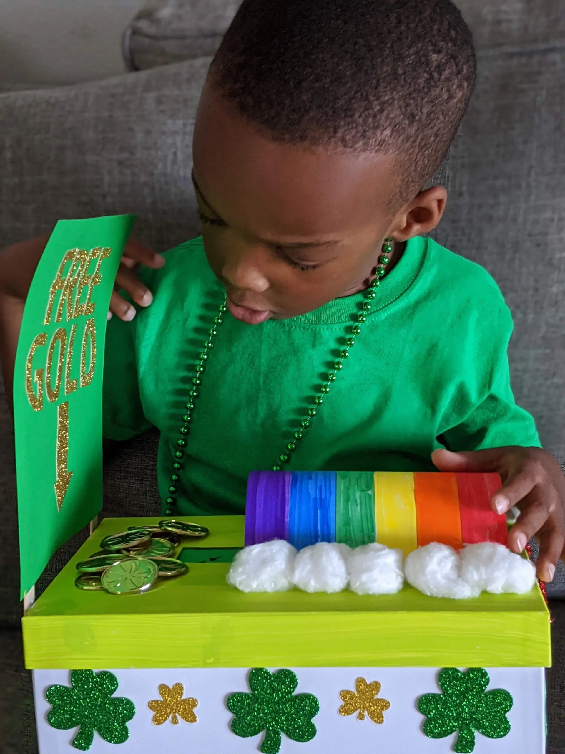 Black boy holding DIY leprechaun trap