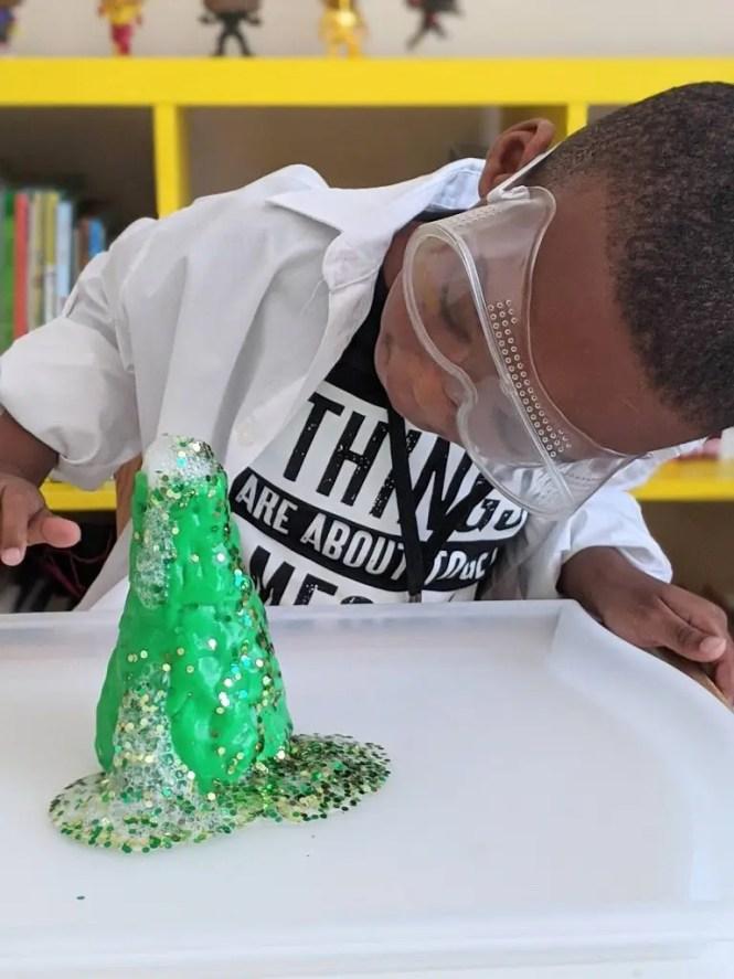 Black boy dressed up as a scientist