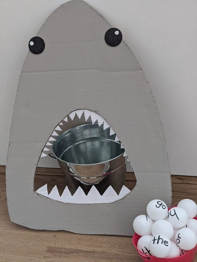 Feed the shark game for kids using table tennis balls and recycled cardboard