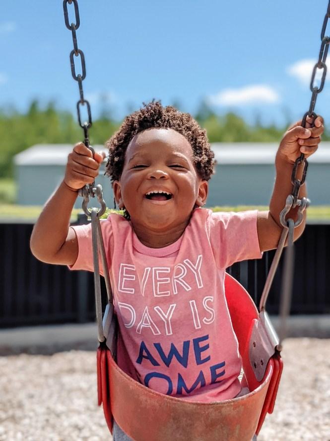 toddler swinging at playground