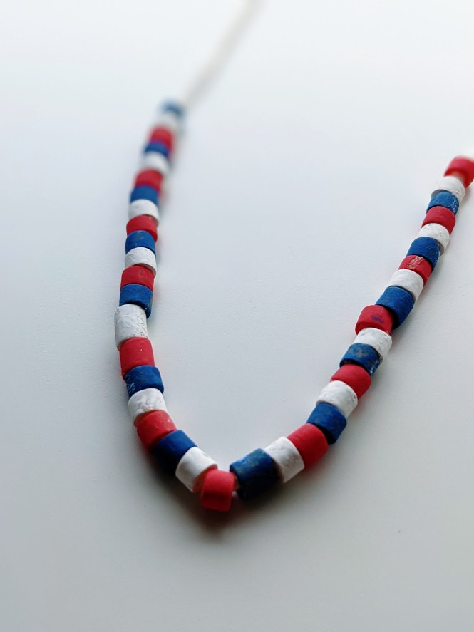 Juneteenth pasta necklace craft for kids