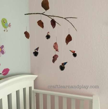 Simple DIY nature mobile with leaves and pinecones