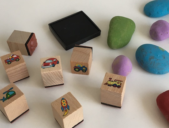 painted stones and stamping set to make story time rocks