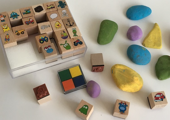 painted rocks and stamps for making story time objects and characters