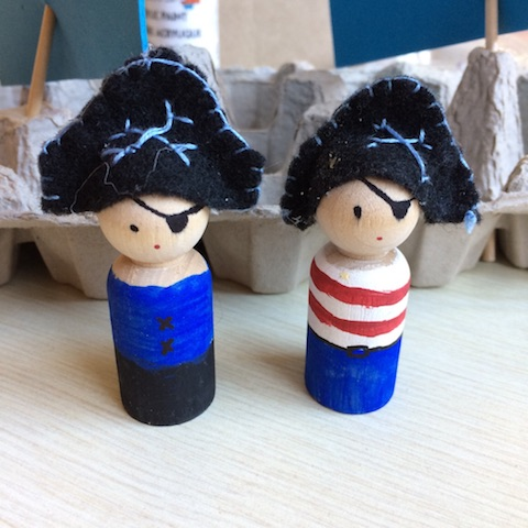 Pirate peg dolls with felt pirate hats would make a durable toy for toddler or preschooler.