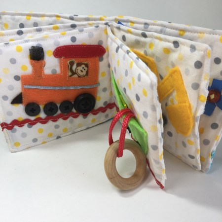 quiet book for babies with teething ring