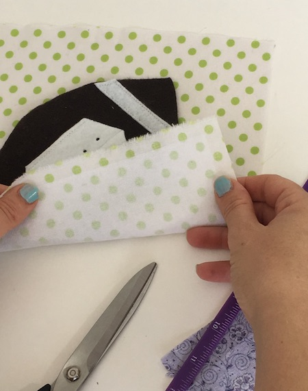 Use fusible interfacing to make quiet book pages stiff. Click to see how to sew fabric quiet book pages.