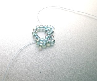 Continue stringing 3 beads through every other bead.