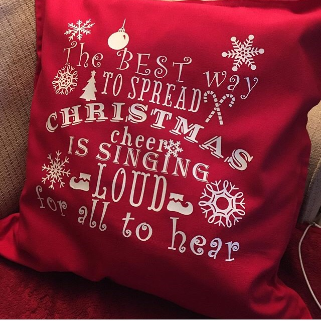 "Finished cushion reading ""the best way to spread Christmas cheer is singing loud for all to hear"""