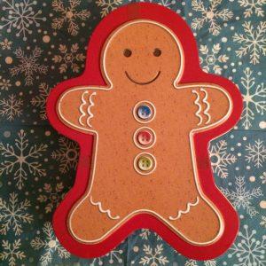Christmas Treats Tin shaped like a gingerbread man