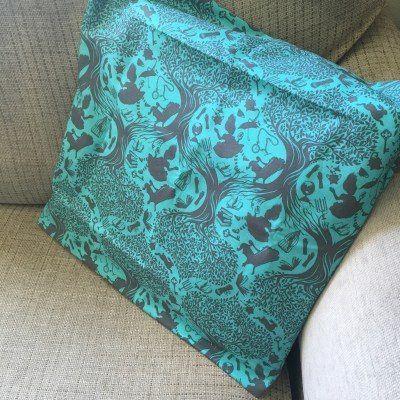 """Alice in Wonderland envelope cushion cover in teal and grey colours """"Down the Rabbit Hole"""" design"""