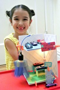 This girl has just made a mechanically functioning car-wash (well, sort of), thanks to the motor, electronic circuitry, and story-telling elements that are part of a toy-kit for girl makers called Roominate.