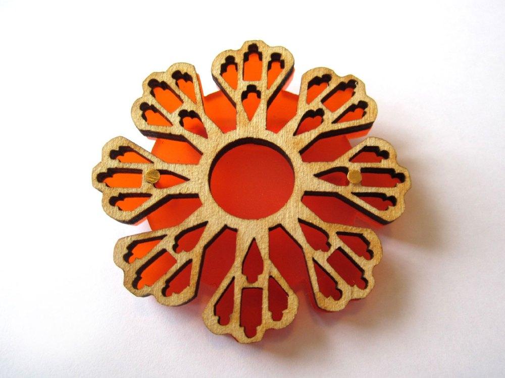 Large lasercut orange brooch made by Shelanu.