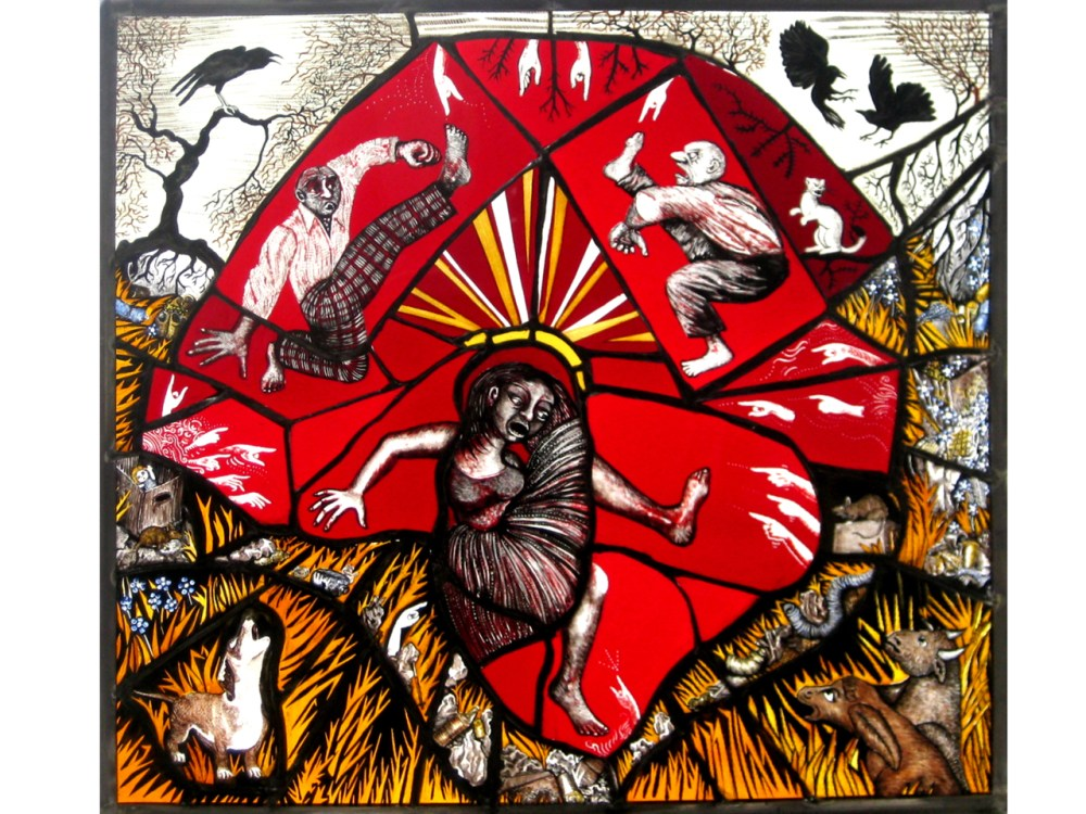 An intricate stained glass window - animals surround the outside of the piece, with three humans at the central.
