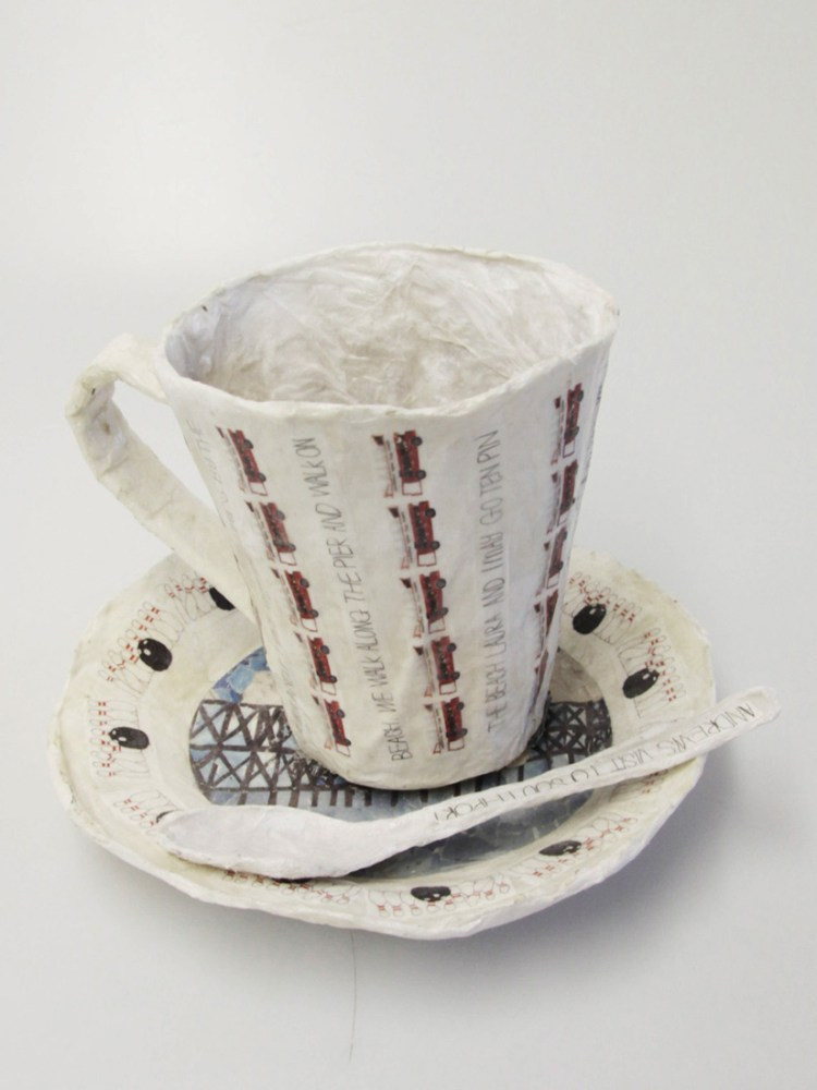 A teacup, saucer and spoon made from paper.
