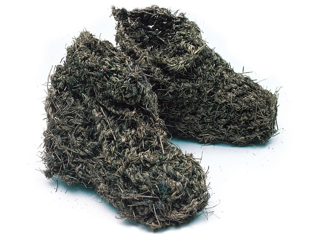 A pair of boots made from grass.