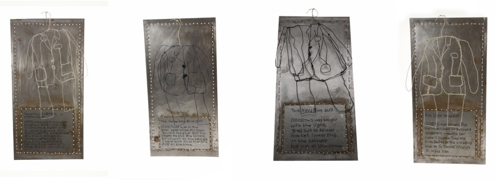 Four plaques of metal with wire hanging from them. The wire depicts the shape of a suit.