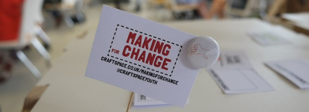 Making for Change card and small badge with drawn stitch fist logo