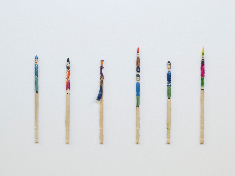 Six wooden pencils with various characters painted on to them in bright colours.