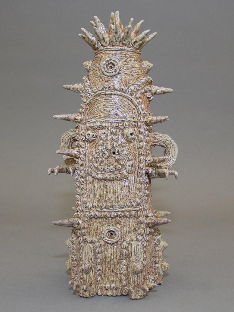 An intricate ceramic figure.