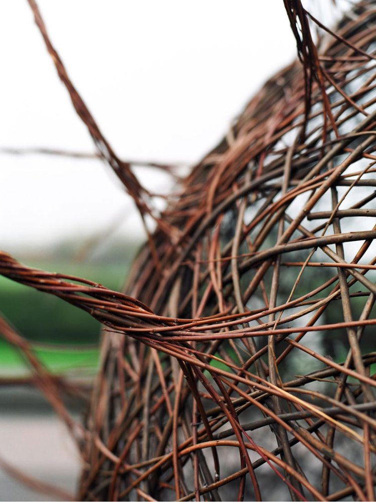 A detailed close up of a willow sculpture.