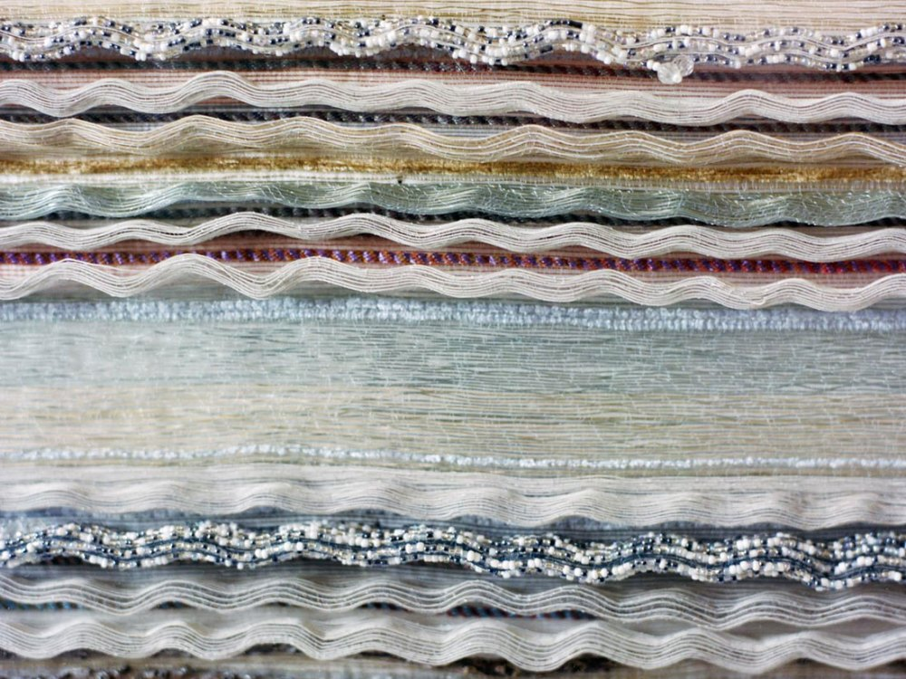 Detail of the final woven cloth, using neutral colours and embellishments.