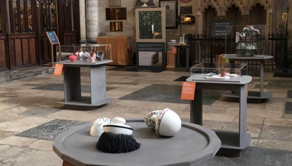 Exhibits are displayed in an old cathedral.