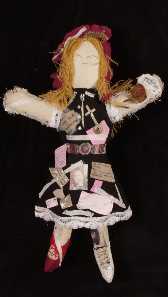 A series of pictures and memories stitched in to a textile doll.