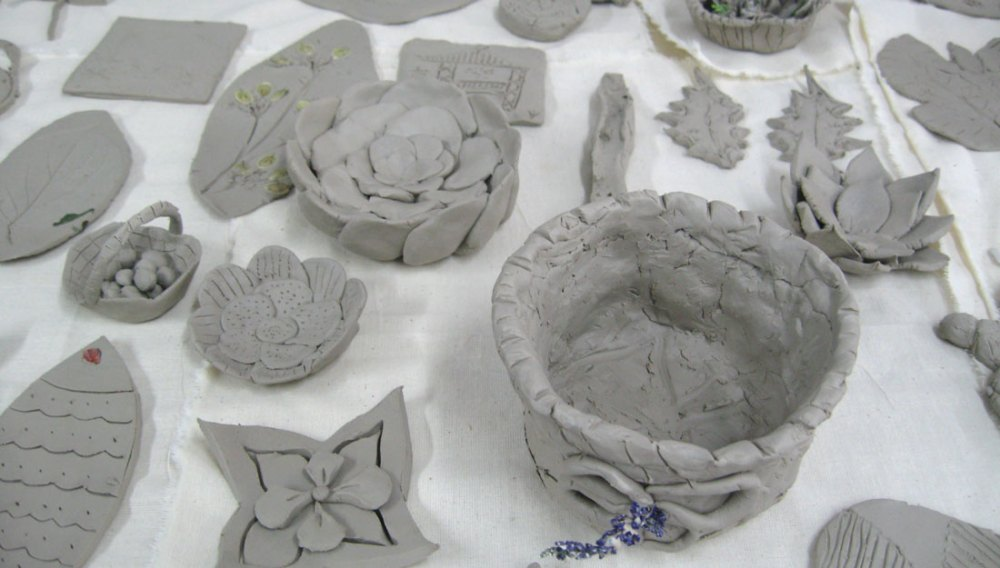Various pieces made out of clay sit on a tabletop.
