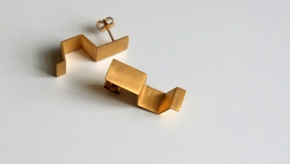 Shelanu Interlocking Stories earrings in gold. Simple in design.