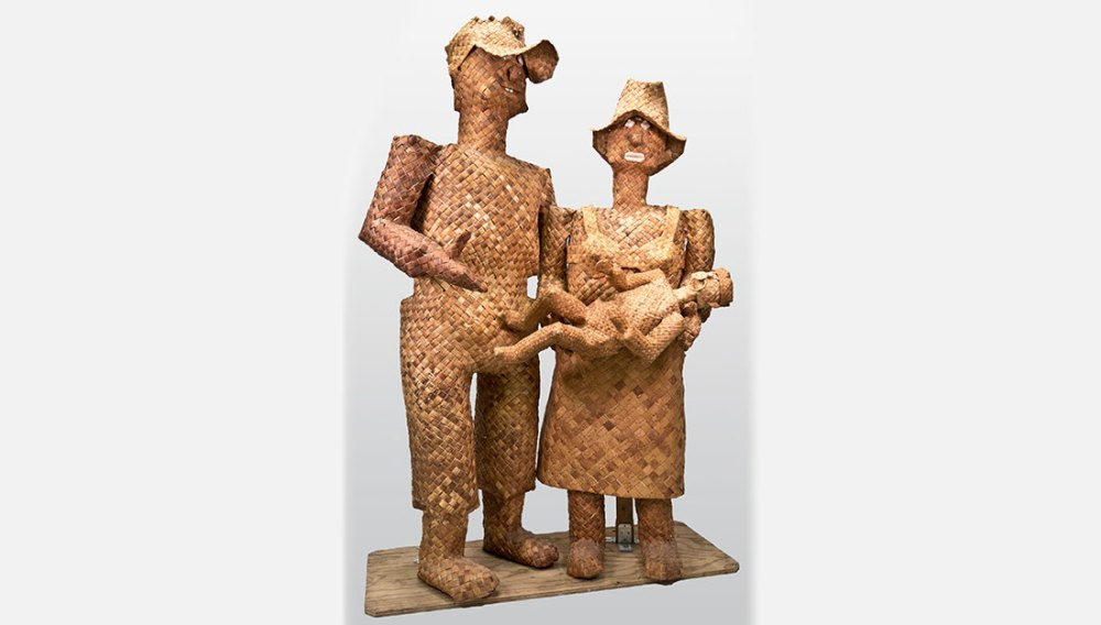 woven sculpture of man, woman holding a child