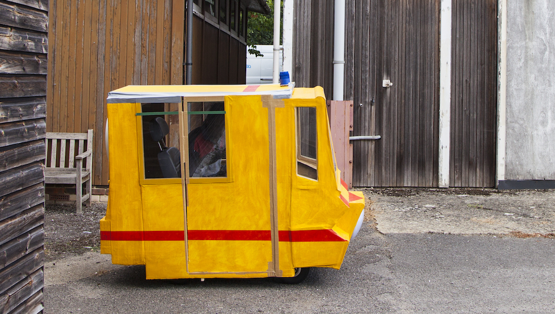 yellow cardboard mobile structure